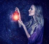 stock photo of starry night  - Beautiful woman with magic lantern on starry sky background - JPG