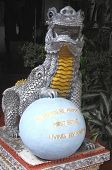 foto of karma  - Sitting silver dragon with a yellow chest  - JPG