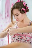 stock photo of libido  - Young teen girl focused on measuring breast - JPG