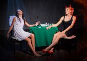 picture of angel devil  - Angel and devil with drugs in dark room - JPG