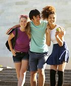 stock photo of school building  - cute group of teenages at the building of university with books huggings - JPG