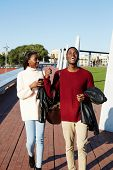 foto of mans-best-friend  - Full length of cheerful university students walking on campus young stylish students walking during the break friends having a great time together two college friends laughing having good time - JPG