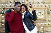 picture of love making  - Best friends fooling around making self portrait with digital camera on phone beautiful stylish couple taking a self portrait with smart phone tourist man and woman making self portrait with phone - JPG