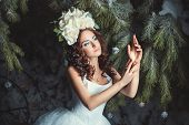 foto of faerie  - Beautiful girl in a fairy winter forest flowers on the head - JPG