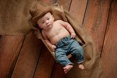 pic of wooden crate  - A four month old baby boy wearing a crocheted cowboy hat - JPG