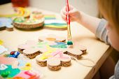 pic of finger-painting  - Little girl painting with colorful paints. selective focus ** Note: Shallow depth of field - JPG