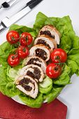 foto of butter-lettuce  - Delicious turkey breast roulade cut in slices stuffed with prunes and almond - JPG