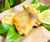foto of cod  - Piece of cod fried on lemon leaf