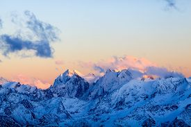 stock photo of mountain-high  - Mountain inspirational landscape beautiful sunset on Ushba autumn or winter in Caucasus Mountains Russia and Georgia - JPG