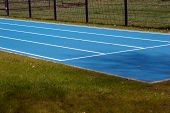 picture of race track  - Blue Tartan race track with guide lines - JPG