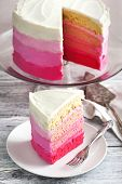 stock photo of ombre  - Delicious Homemade Vanilla Cake In Pink Ombre - JPG