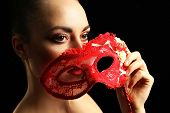 picture of masquerade  - Portrait of beautiful woman with fancy glitter makeup and masquerade mask on dark background - JPG
