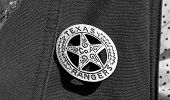 picture of texas star  - Old Texas ranger cowboy badge in black and white - JPG