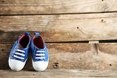foto of shoes colorful  - Colorful toddler shoes on wooden background - JPG