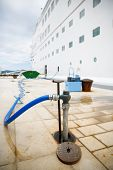 picture of passenger ship  - Ground service refilling docked cruise ships water tanks in port during a stop and sightseeing tour for passengers on cruise marine roundtrip - JPG