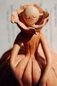 pic of figurines  - The earthenware handmade statuette made from red material - JPG
