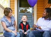 foto of racial diversity  - a cute diverse family sitting on a porch  - JPG