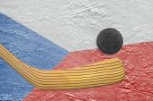 picture of hockey arena  - Hockey puck hockey stick and the image of the Czech flag on the ice - JPG