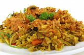 stock photo of indian food  - indian chicken and prawns in yellow rice - JPG