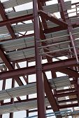 stock photo of tatas  - A detailed view of red steel structure and standard metal profiled decking - JPG