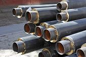 picture of insulator  - Steel pipe with heat insulation on construction site - JPG