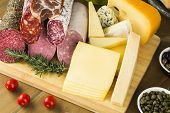 picture of cheese platter  - Assorted Cold cuts and cheese on table - JPG