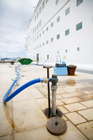 image of water shortage  - Ground service refilling docked cruise ships water tanks in port during a stop and sightseeing tour for passengers on cruise marine roundtrip - JPG