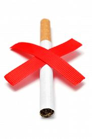 stock photo of tobacco smoke  - a cigarette and two crossed red slashes - JPG