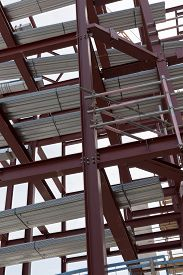 foto of tatas  - A detailed view of red steel structure and standard metal profiled decking - JPG