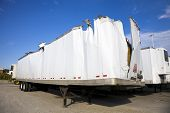 pic of oversize load  - White trailer after accident against blue sky - JPG