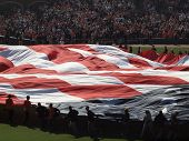 People Run As They Unravel Giant Flag In The Middle Of Field To Celebrate America