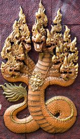pic of serpent  - Stone carving serpent is the belief of Buddhists in Thailand  - JPG