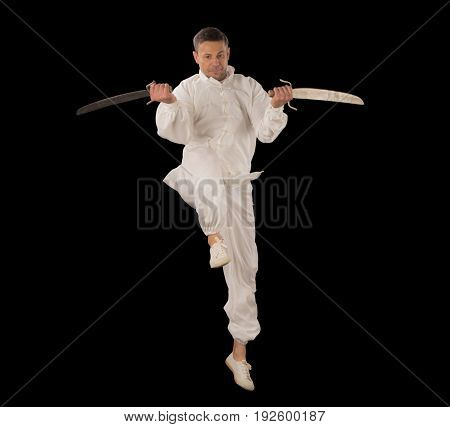 Man wearing all white with two swords