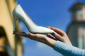 Footwear Or Shoe White Color Leather On Female Hand poster