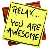 Relax, you are awesome - reminder or positive affirmation - handwriting on an isolated sticky note poster