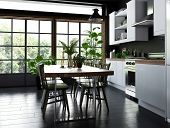Dining table and chairs in an open plan kitchen with fitted cabinets and appliances in front of larg poster