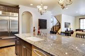stock photo of over counter  - Kitchen with view looking over center island into great room - JPG