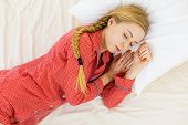 Relax Rest Sleep Positions Concept. Girl Drowning In Dreams. Young Woman Wearing Red Dotted Pajamas  poster