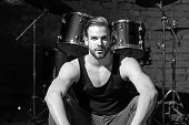 Beat Of Drums. Rock Star Or Rocker. Enjoying Instrumental Music. Handsome Man Sit On Stage At Percus poster