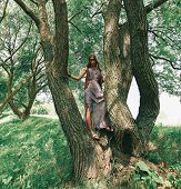 Young Woman Hippy Near A Big Tree poster