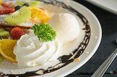 Whipped Cream Ice Cream Chocolate Dessert Strawberry Blueberry Kiwi Lemon Waffle Chocolate Dessert.  poster