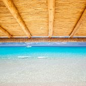 Cane sunroof with tropical perfect beach of turquoise water view [photo illustration]
