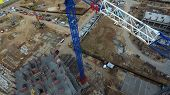 Top View Of Construction Site With Crane. Scene. Crane Stands Above Roofs Of Buildings On Constructi poster