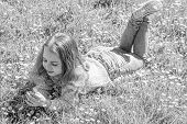 Allergy Concept. Girl With Long Hair Lying On Grassplot, Grass Background. Girl On Smiling Face Hold poster