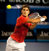 MELBOURNE - JANUARY 22:Roger federer of Switzerland in hiw fourth round win over Bernard Tomic of Au