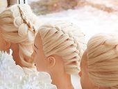 Braiding Braids On A Mannequin. Close Up poster
