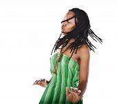 stock photo of rastafari  - Rasta woman dancing reggae with closed eyes feeling the music - JPG