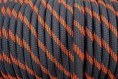 Black Rope On A Show-window Of Shop. A Saving Rope For Climbers. The Rope Is Reeled Up On The Coil.  poster