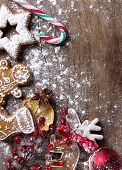 stock photo of cariboo  - Traditional christmas Gingerbread cookies over wooden background - JPG