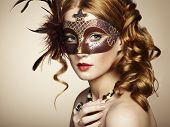 picture of female mask  - Beautiful young woman in brown mysterious venetian mask - JPG